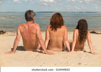 Young beach nudists