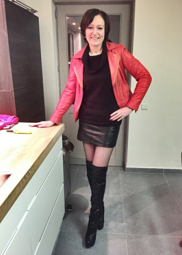 Mature in leather skirt